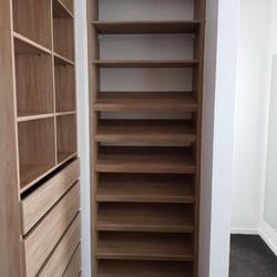 Full colour WIR using Laminex Sublime Teak MR MDF . No backing. Raised lip drawer fronts and secondary top shelf. Combination of flat and sloping shoe shelves