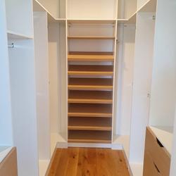 White HMR Melamine with Polytec Natural Oak matt sloping shoe shelves and scalloped drawer fronts