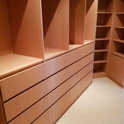 Full colour WIR using DR Henderson Sonova Beech. Full colour backing. Raised lip drawer fronts, tilt forward laundry hamper. Designer to suit angled wall for maximum storage