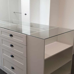 White WIR with shaker profile drawer fronts. Centre Island with seat & glass top. Sloping shoe racks with upstands and slide out scarf cupboard
