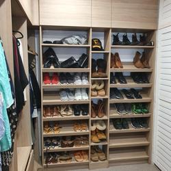 WIR using Polytec Maison Oak Matt. Overhead hinged doors. Sloping shoe racks with upstands