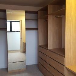 Laminex Elegant Oak WIR. Secondary top shelf. Raised lip drawer fronts. Tilt forward laundry hamper. Hinged mirror door