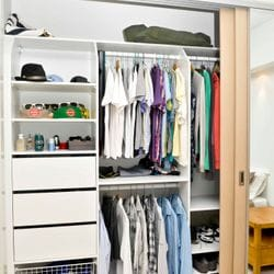 Build in robe using White HMR Melamine with open drawer fronts, basket and flat shoe shelves