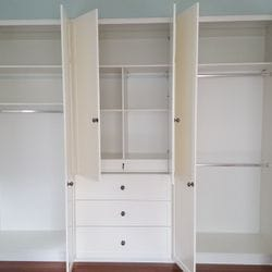 Built in robe using White HMR Melamine with chrome hanging rail, drawers, recessed drawer for jewellery tray and shelving