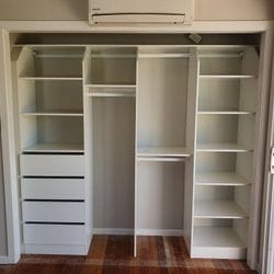 BIR using White HRM Melamine with recessed top shelf, open drawer fronts and shelving