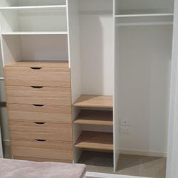 Build in robe using White HMR Melamine and Polytec Natural Oak Matt with scalloped drawer fronts