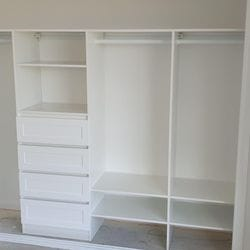 Built in robe using White HMR Melamine with closed drawers with profile drawer fronts