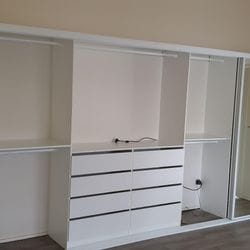 Built in robe using White HMR Melamine with open drawer fronts and double hang using white hanging rail