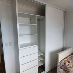 BIR using White HMR Melamine with raised lip drawer fronts and shelving