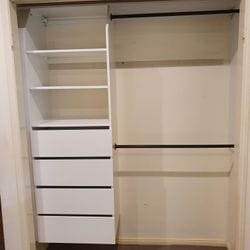 Suspended built in robe using White HMR Melamine with open drawer fronts, shelving and double hang using black hanging rail