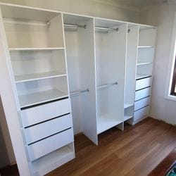 Built in robe using White HMR Melamine with open drawer fronts, shelving and double hang using chrome hanging rail