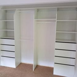 Built in robe using White HMR Melamine with open drawer fronts and shelving