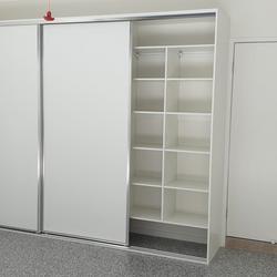 Garage storage with sliding doors. End wall panel using white HMR Melamine. Glacier vinyl sliding doors
