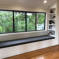 Day lounge/ window seat with book & drawer storage. 2 pack painted finish. Shaker profile drawer fronts & end feature panel. Bulkhead to suit ceiling