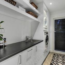 """Laundry fit out using Polytec """"Polar White sheen"""" and 33mm black matt post form bench top"""