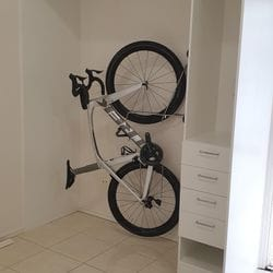 Garage storage for this keen cyclist. Steady rack for bike, rail for jerseys, shelf for helmets and drawer for gloves, socks, repair kits etc.