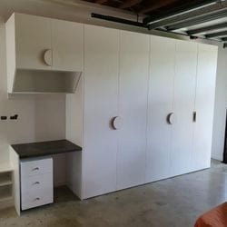 Garage storage to incorporate desk top, shoe shelving and mobile drawer box. White HMR Melamine.
