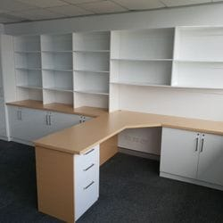 "Fit out for Barristers chambers using Polytec ""Polar White Sheen"", 33mm post form desk top using Polytec ""Tuross Oak"". All doors and drawer installed with locks"