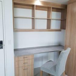 "Study & storage for Q1 apartment. Desk top using Flexipanels ""Concrete"",cabinets using Polytec ""Natural Oak Matt"""