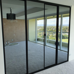 1 set of 4 fully framed 4mm vinyl backed dark grey mirror sliding doors. Dias black aluminum trims & tracks