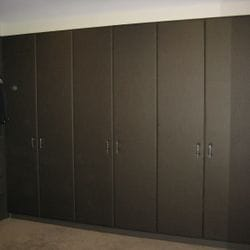 """4 sets of 2 hinged doors covered in """"leather look"""" fabric."""