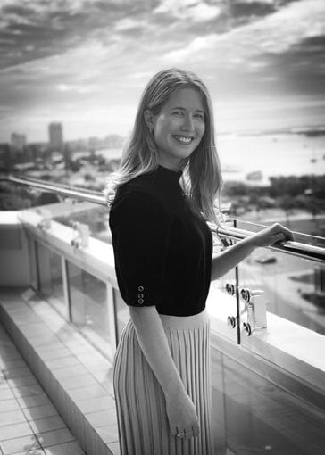 Laura Slogrove - Legal Secretary standing on balcony at IP Partnership | Our Team | Lawyers | Intellectual Property