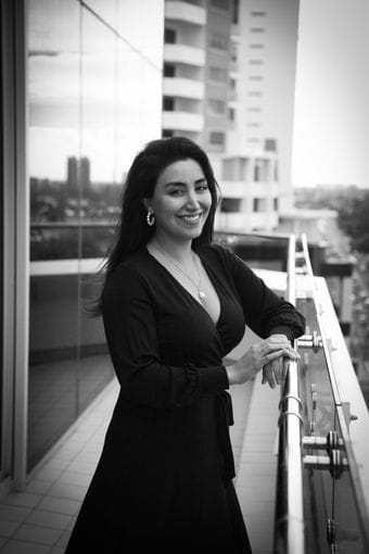 Ania Salehirad Sitting at a desk in IP Partnership | Our Team | Lawyers | Intellectual Property