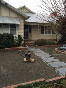 Preparing a base for artificial turf