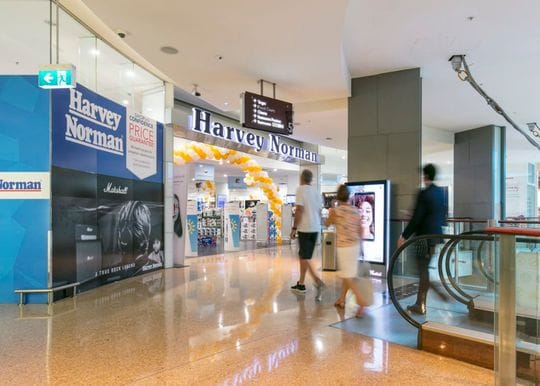 Harvey Norman succumbs to pressure, repays JobKeeper after electrified profit