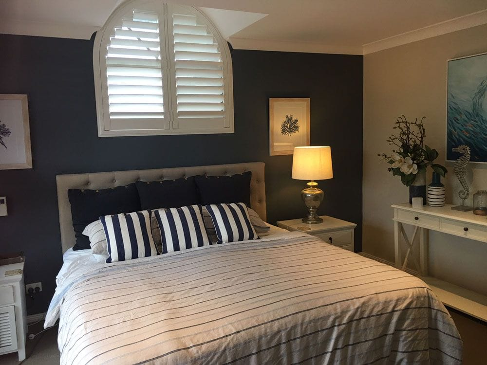 Custom shaped plantation wood shutters are a great solutoin for custom those unusually shaped windows