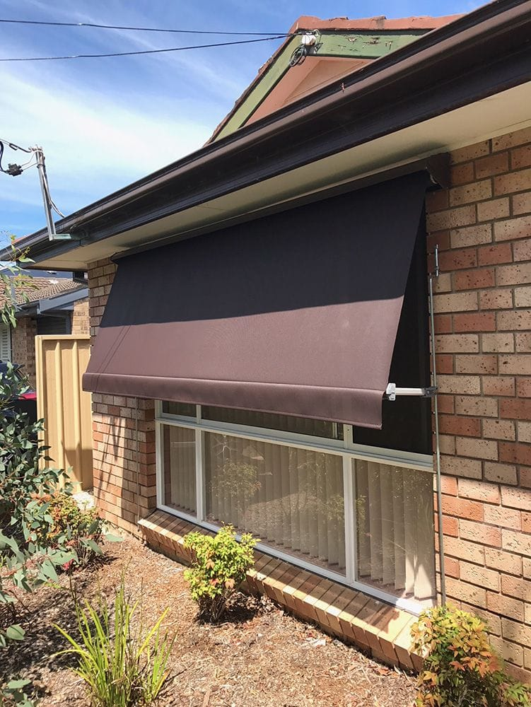 Automatic Lock Arm Awning over Window
