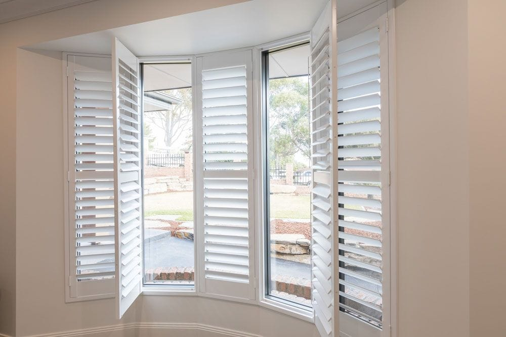 Bay windows look great with hinged plantation wood shutters. They can just as easily be set as bi-fold or sliding operation.