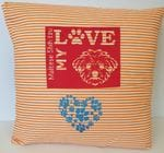 Orange stripped pillow with puppy banner