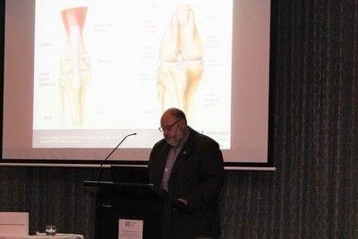 Veterinary doctor addressing delegates at conference
