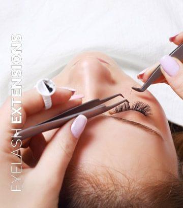Technician applying lash extensions