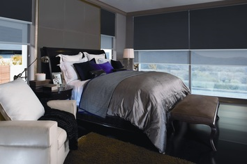 Quantum Dual Roller Blind in a bedroom setting. This image showcases block out roller blinds and sunscreen or sheer roller blinds that are fixed on dual brackets creating a day and night blind.