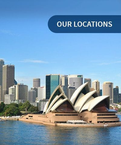 Sydney Opera House and Sydney Harbour in front of Sydney City - Our Locations | Synthetic Grass and Rubber Surfaces