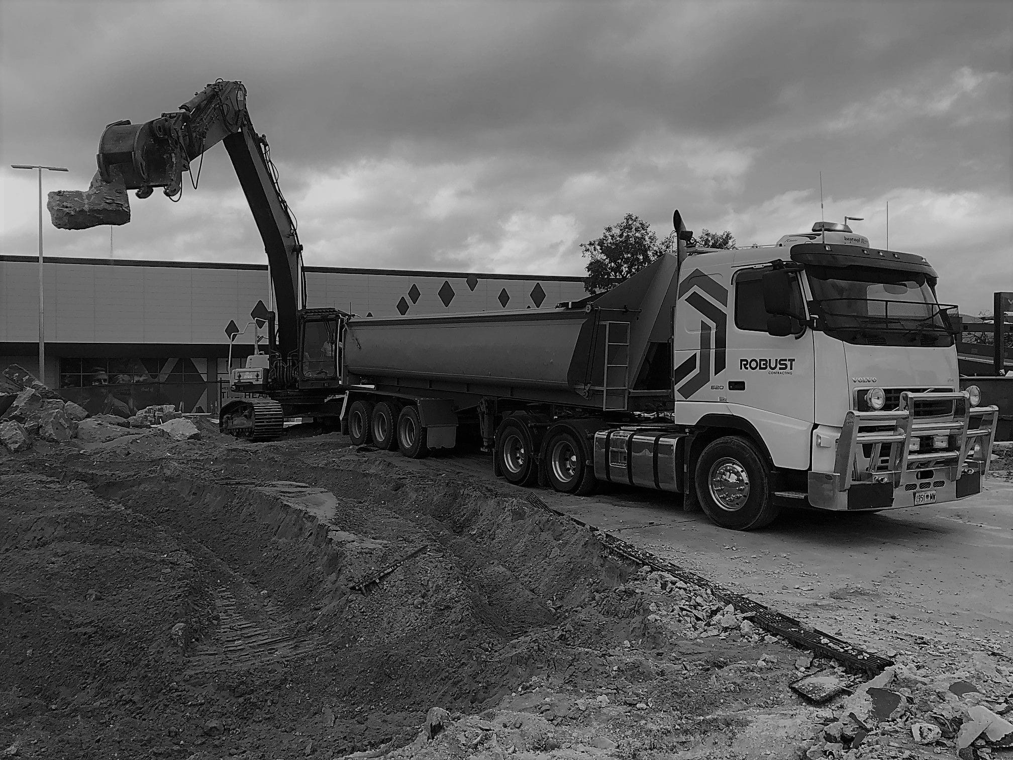 Earth Working, Excavation, Drainage and Retaining Wall System services to the commercial and industrial construction market