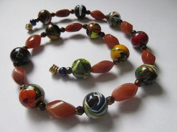 Hand-painted wooden beads with amber adventure and fancy glass brass
