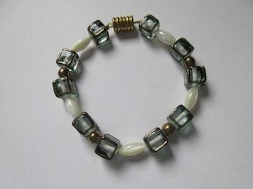 Pearl/smoke-glass and fancy brass with magnetic closure