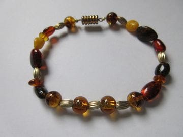 Amber chips with fancy brass glass and magnetic closure
