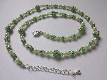 Fancy emerald green crystals, pearls, rhinestones