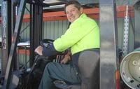 Alan driving Superior Fences forklift