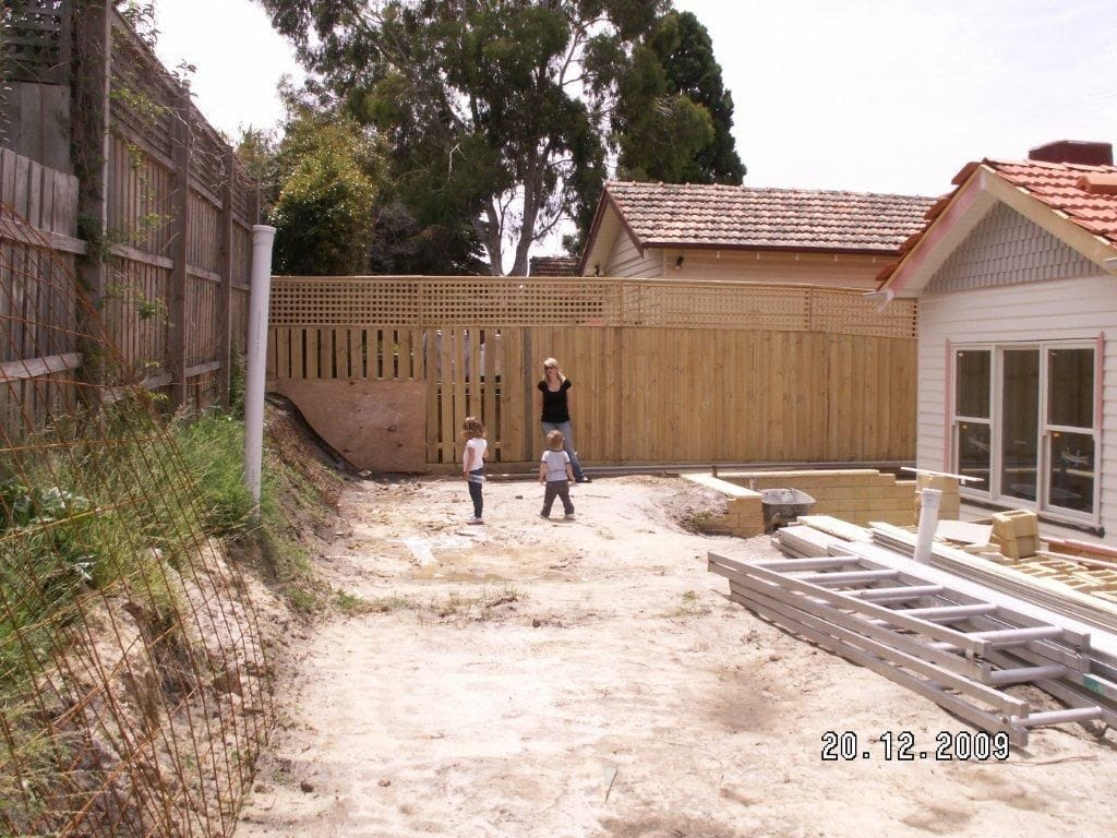 before installing retaining wall and paving