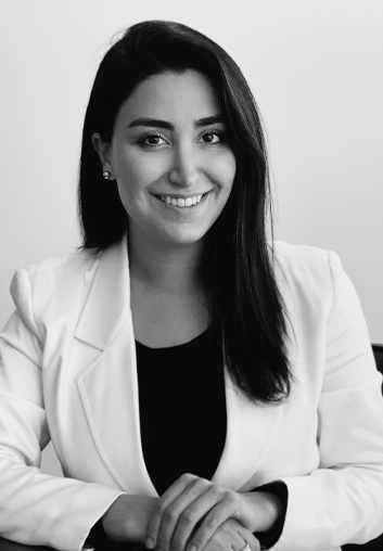Ania Salehirad - BA, MBA, JD sitting at a desk in IP Partnership | IP Partnership | Our Team | Lawyers