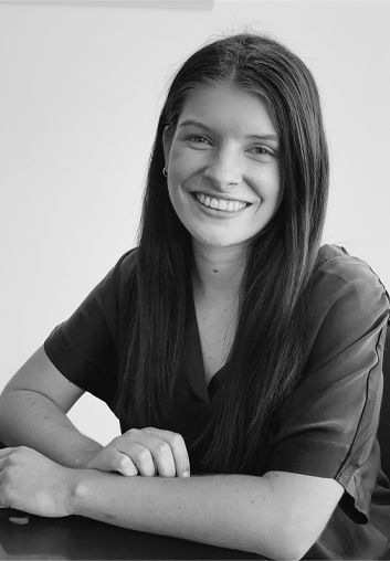 Molly Flynn - LLB (Hons.) B.Comm Sitting at a desk in IP Partnership | Our Team | Lawyers | Intellectual Property
