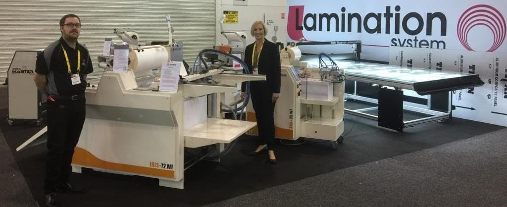 Dylan & Sarah standing next to Automatic Laminators on our stand at the PacPrint trade show