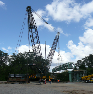 Crane successfully lifting water main