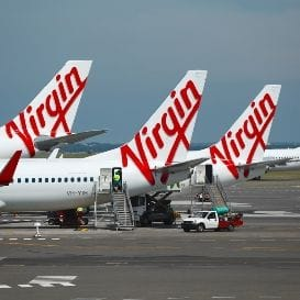 VIRGIN TREBLE'S FULL YEAR LOSS