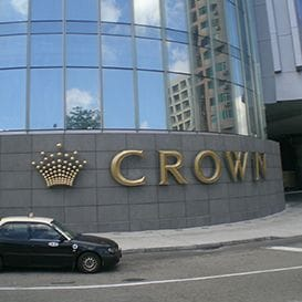 CROWN EXITS MACAU TO PAY DOWN DEBTS